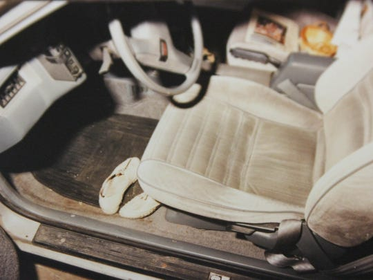 This photograph, which had not previously been released to the public, shows the inside of the 1986 Oldsmobile Cutlass Calais that Paige Renkoski was driving when she disappeared from the shoulder of westbound Interstate 96. The car was found still running, her shoes and purse inside.