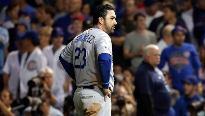 Los Angeles Dodgers first baseman Adrian Gonzalez reacts after being tagged out during the sixth inning against the Chicago Cubs in Game 2 of the 2016 NLCS.