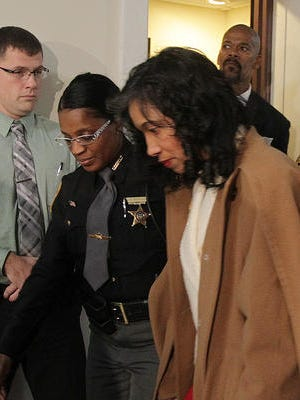 Suspended Judge Tracie Hunter, right, leaves Hamilton County Common Pleas Court after being sentenced to six months in jail Friday for her felony conviction on one count of having an unlawful interest in a public contract.