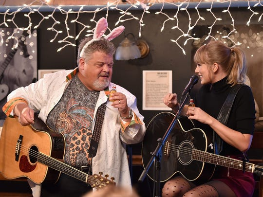 Craig Wiseman and Taylor Swift chat over shots of Fireball Cinnamon Whisky at Bluebird Cafe.