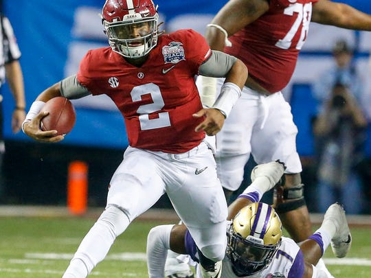 Alabama quarterback Jalen Hurts (2) scrambles for yardage against Washington during the 2nd half of the Peach Bowl NCAA college football game, Saturday, Dec. 31, 2016, in Atlanta. Alabama defeated Washington 24-7. (AP Photo/Butch Dill)
