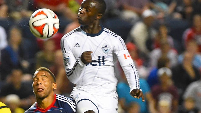 Vancouver FC forward Kekuta Manneh attempts to shoot the ball against Chicago Fire midfielder Matt Watson during the second half at Toyota Park. The Chicago Fire and Vancouver FC ended in a draw 0-0.