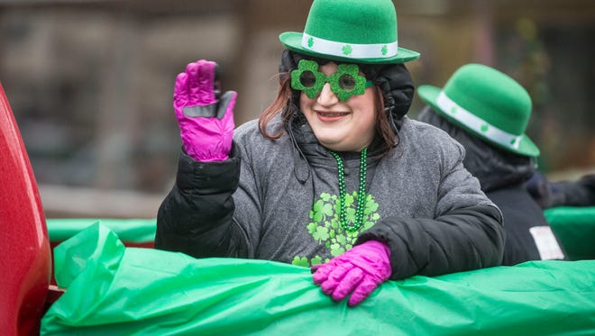 Hundreds came to downtown Muncie for the annual St. Patrick's Day Parade on March 17 down Walnut Street despite cold temperatures and freezing rain.