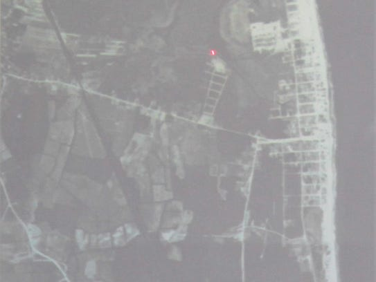 Using satellite images, Town Manager Cliff Graviet