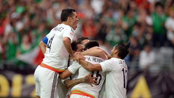 Mexico players reacts after a goal against Uruguay.