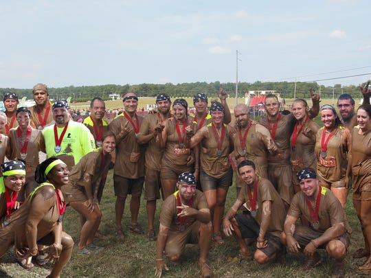 The Cooper Electric team after their 5K dash through the mud.
