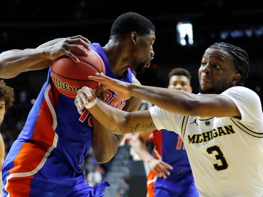 NCAA_Florida_Michigan_Basketball_21617.jpg