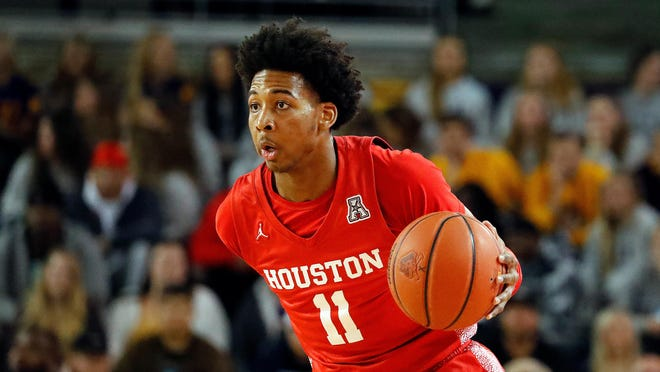 Houston's Nate Hinton (11) brings the ball up the court against East Carolina during the first half of an NCAA college basketball game in Greenville, N.C., Wednesday, Jan. 29, 2020.