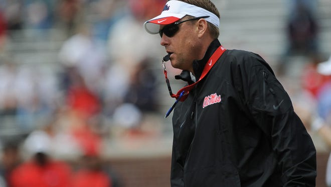 Ole Miss Head Coach Hugh Freeze directs action on the field during Saturday's Grove Bowl.