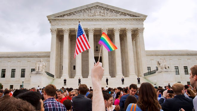 The crowd celebrates June 26, 2015, outside of the Supreme Court in Washington, D.C., after the court declared that same-sex couples have a right to marry anywhere in the country.