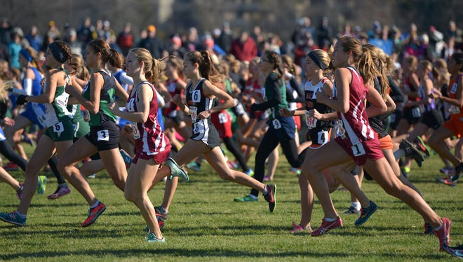 Participants begin the state girls Class A cross country championship race Saturday at St. Olaf College in Northfield.