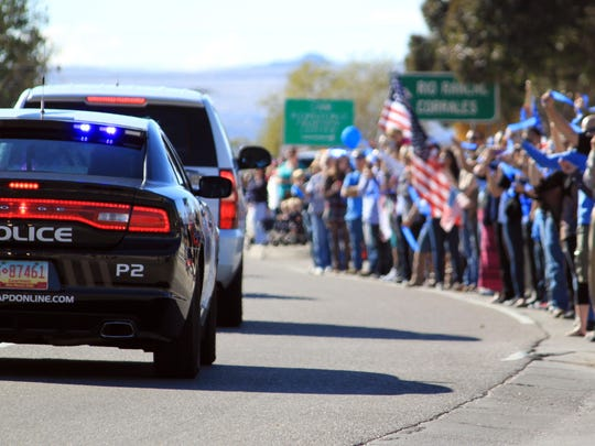 Thousands of people line the route for slain Albuquerque