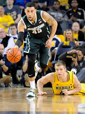 MSU's Denzel Valentine steals the ball from Michigan's Max Biefeldt and heads up court Tuesday in Ann Arbor.
