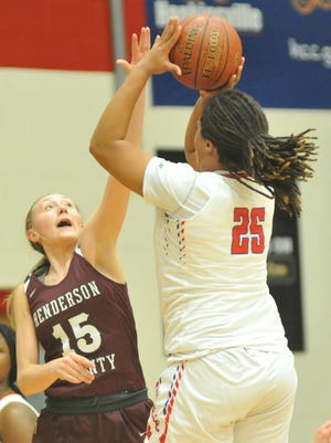 Henderson County's Alyssa Dickson attempts to block the shot of Christian County's Trinitee Jackson during the first half of Thursday's game in Hopkinsville