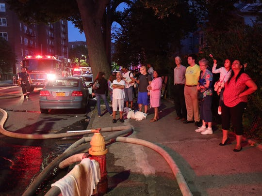 Residents watch as the Yonkers Fire Department works