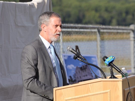 Monmouth University President Grey J. Dimenna speaks about a plan to build a science station along the Navesink River