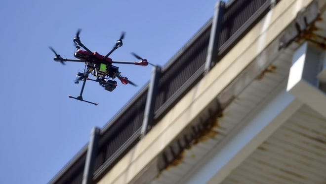 An Align M690L drone flies Aug. 23, 2016, along the northbound side of the Gold Star Bridge to photograph and record video for bridge inspection in Connecticut.