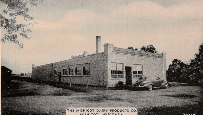 This postcard photo shows the former home of the Mishicot Dairy Products Co., once across the street from what today is the Mishicot High School greenhouse.