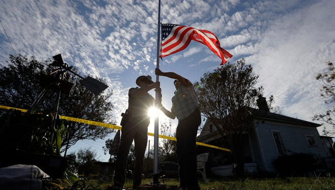 Lowering the flag to half-staff near First Baptist Church of Sutherland Springs, Texas, Nov. 6, 2017.