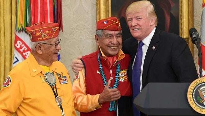President Donald Trump meets with Navajo Code Talkers Peter MacDonald, center, and Thomas Begay, at the Oval Office.
