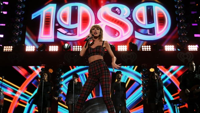"""Taylor Swift, who is seeking to trademark the phrase """"party like it's 1989,"""" performs Dec. 12 in New York City."""