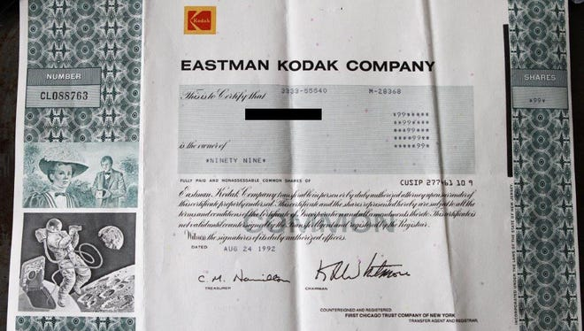Kodak stock shares dated Aug. 24, 1992, and signed by Kay Whitmore.