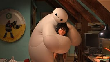 """This image released by Disney shows animated characters Hiro Hamada, voiced by Ryan Potter, right, and Baymax, voiced by Scott Adsit, in a scene from """"Big Hero 6."""" (AP Photo/Disney)"""