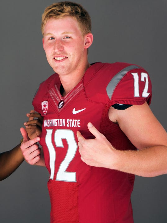 FILE -This July 23, 2014, file photo, shows Washington State quarterback Connor Halliday posing for a photo at the 2014 Pac-12 NCAA college football media days in Los Angeles. Washington State rode the arm of quarterback Halliday to its first bowl game in a decade last year, and Cougar fans can expect more of the same this season. (AP Photo/Damian Dovarganes,File)