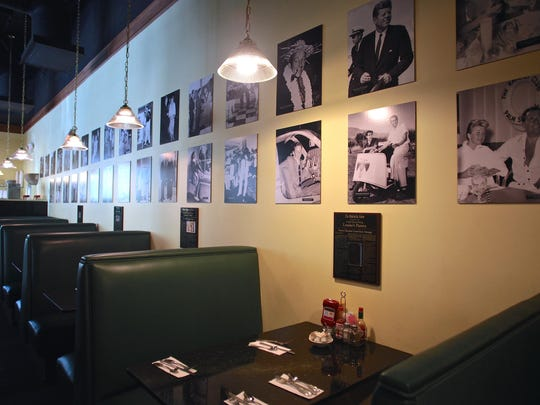 Vintage photographs of celebrities and public figures from the Palm Springs Historical Society decorate the walls of Louise's Pantry in La Quinta.