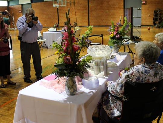 Family members take photos of Charlene Chesshir (foreground)