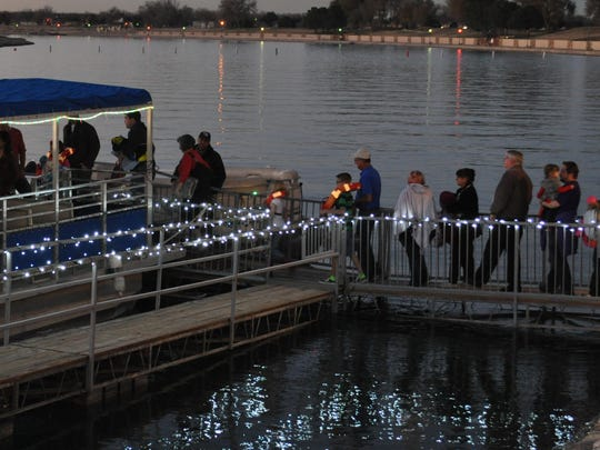 A line of guests waits to board the first boat to go out during the 2014 Christmas on the Pecos season.