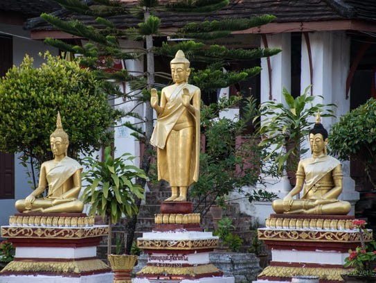 Golden Buddha statues in the courtyard of a monastery