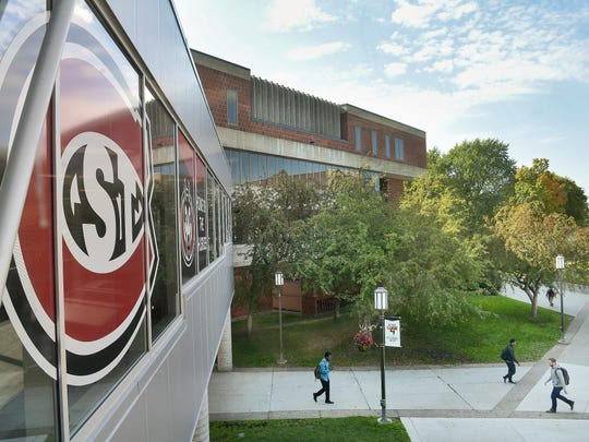 Students make their way between classes Tuesday at St. Cloud State University. Policies guiding firearms are similar among the area colleges and universities.