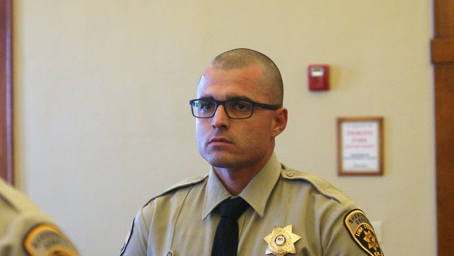 Luna County Sheriff's Deputy Robert Nordorf listens as Sheriff Kelly Gannaway salutes him for a courageous rescue.
