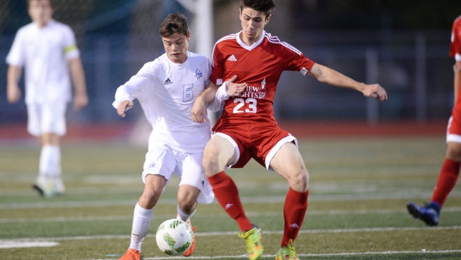 Fort Collins High School's Logan Katzman and Fairview High School's Fred Johnson vie for the ball in a soccer match at French Field on Monday. Fairview won 3-2.