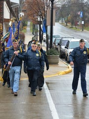 Lloyd Nimmer, right, commands the honor guard for the Kewaunee Veterans Day observance on Tuesday.