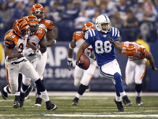 Marvin Harrison heads upfield after a catch and 66