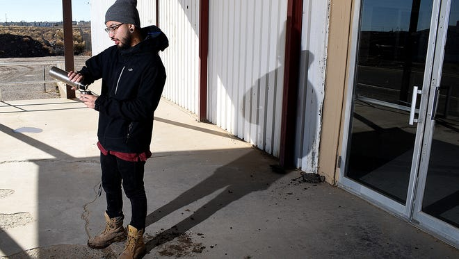 Music promoter Anthony Lee of War Party Productions stands outside his new venue, Asterix, on Dec. 24 in Shiprock.