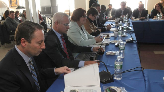 Members of the Tappan Zee Mass Transit Task Force, including Westchester County Executive Robert Astorino, left,  meet in Tarrytown Feb. 28, 2014 to receive the final report on its recommendations.
