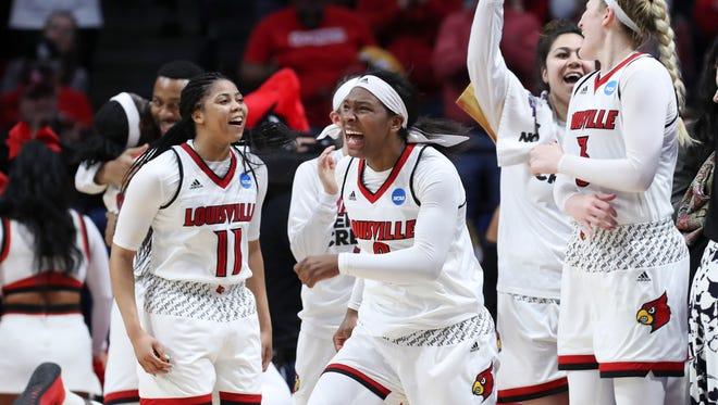 Louisville's Myisha Hines-Allen (2) and Arica Carter (11) celebrate their win over Oregon State during their NCAA Elite 8 matchup at Rupp Arena in Lexington.    Mar. 25, 2018