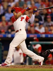 Philadelphia Phillies' Cesar Hernandez follows through on a three-run triple during the second inning of a baseball game against the Chicago Cubs, Friday, Aug. 25, 2017, in Philadelphia.  (AP Photo/Laurence Kesterson)