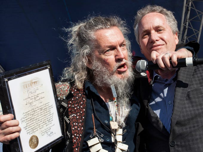 """Poet Ron Whitehead celebrates as Mayor Greg Fischer officially declares Louisville as """"Gonzoville"""" during GonzoFest 2014. The festival, in its third year, celebrates the life and times of Louisvillian and famous writer Dr. Hunter S. Thompson. April 5, 2014"""