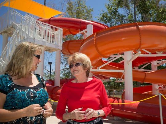 Councilwoman Thelda Williams (right) talks with Phoenix aquatics supervisor Becky Hulett at Cortez Pool.