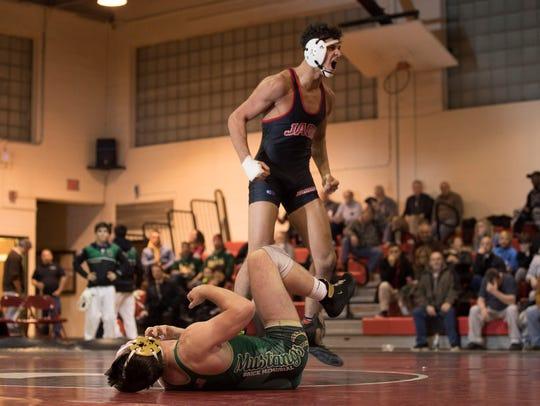 Jackson Memorial 170-pounder Kyle Epperly celebrates