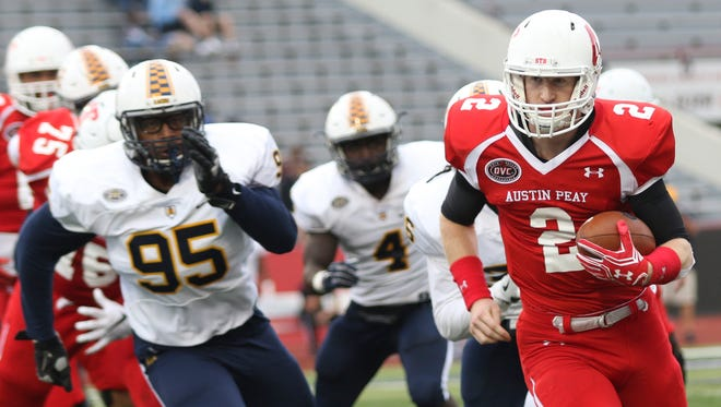 Austin Peay quarterback Tommy Hays (2) scrambles and finds his way into the end zone during their game against Murray State at Fortera Stadium on Saturday.