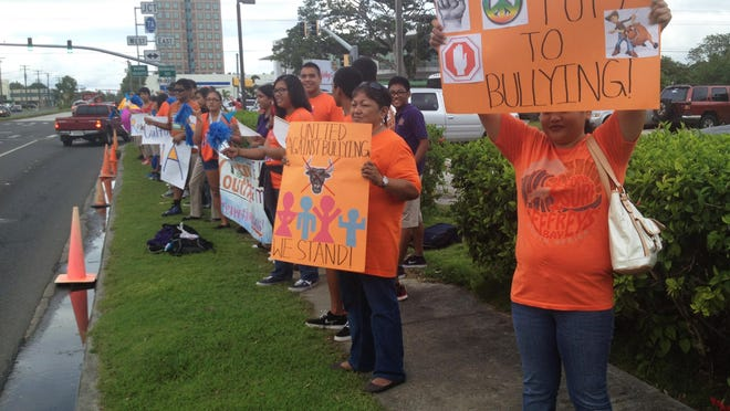 Students and others participate in an anti-bullying wave in front of the Agana Shopping Center in October 2013. Girl Scout Troops and other youth organizations to join Guam Girl Scout cadettes for an anti-bullying wave at the Tamuning ITC intersection at 4:30 p.m., Oct. 19, for this year's Pacer's Anti-Bullying Unity Day.