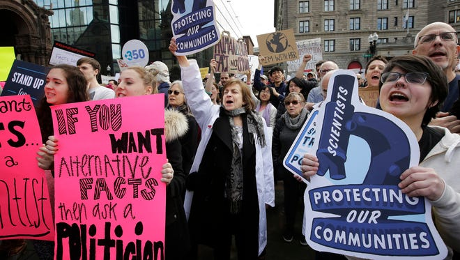 Members of the scientific community, environmental advocates and supporters demonstrate in favor of climate change research in Boston last month.