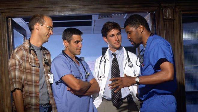 """Dr. Mark Greene (Anthony Edwars), left, Dr. Doug Ross (George Clooney), Dr. John Carter (Noah Wyle) and Dr. Peter Benton (Eriq La Salle) were four of the medical professionals working at Chicago's County General Hospital in NBC's """"ER."""""""
