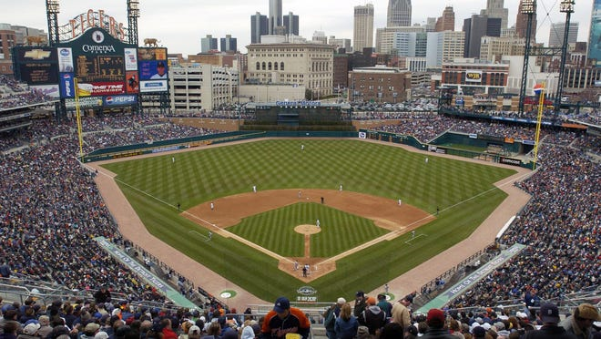 FILE - In this April 8, 2004, file photo, Baseball fans fill Comerica Park as the Detroit Tigers play the Minnesota Twins in an opening day baseball game in Detroit.