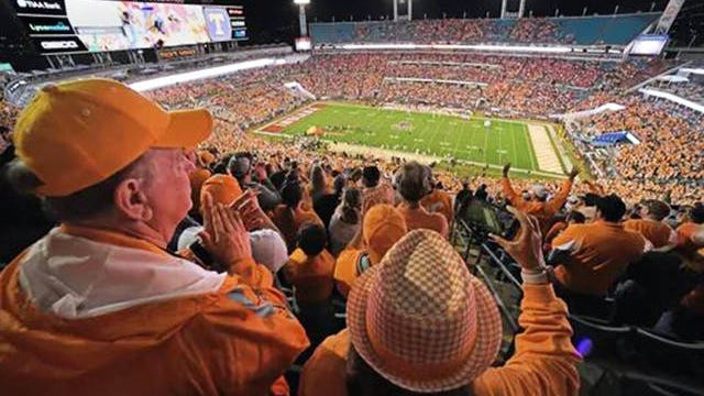 Tennessee fans cheer as the Volunteers football team takes the field for their matchup against the Indiana Hoosiers in the 2020 TaxSlayer Gator Bowl in Jacksonville, Florida's TIAA Bank Field on Jan. 2.